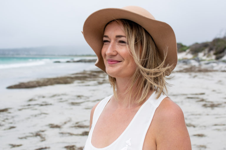 Portrait of Emily Smith at beach, owner of Be Think Do, mindset coaching for busy women