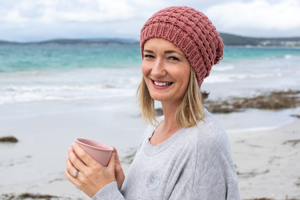 Emily Smith, women's Life Coach, smiling at the beach